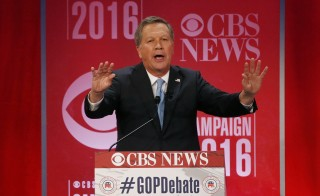 Republican U.S. presidential candidate Governor John Kasich criticizes his rivals for attacking each other at the Republican U.S. presidential candidates debate sponsored by CBS News and the Republican National Committee in Greenville, South Carolina February 13, 2016. REUTERS/Jonathan Ernst - RTX26TSE