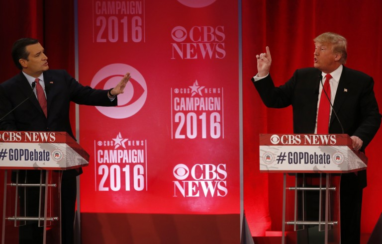 Republican U.S. presidential candidates Senator Ted Cruz (L) and businessman Donald Trump directly debate each other at the Republican U.S. presidential candidates debate sponsored by CBS News and the Republican National Committee in Greenville, South Carolina February 13, 2016.  REUTERS/Jonathan Ernst (TPX IMAGES OF THE DAY)   - RTX26TUW