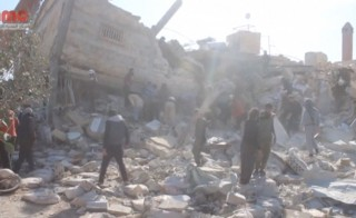 People gather near a destroyed building said to be a Medecins Sans Frontieres (MSF) supported hospital in Marat al Numan, Idlib, Syria, February 15, 2016 in this still image taken from a video on a social media website. French charity Doctors Without Borders/Medecins Sans Frontieres (MSF) said in a statement that at least eight staff were missing after four rockets hit a hospital that it supported in the province of Idlib in north western Syria. REUTERS/Social Media Website via Reuters TVATTENTION EDITORS - THIS PICTURE WAS PROVIDED BY A THIRD PARTY. REUTERS IS UNABLE TO INDEPENDENTLY VERIFY THE AUTHENTICITY, CONTENT, LOCATION OR DATE OF THIS IMAGE. EDITORIAL USE ONLY. NOT FOR SALE FOR MARKETING OR ADVERTISING CAMPAIGNS. NO RESALES. NO ARCHIVE. THIS PICTURE IS DISTRIBUTED EXACTLY AS RECEIVED BY REUTERS, AS A SERVICE TO CLIENTS      TPX IMAGES OF THE DAY      - RTX26ZFD