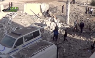People gather near what is said to be a hospital damaged by missile attacks in Azaz, northwestern Syria, on Feb. 15 in this still image taken from a video on a social media website. Image credit: Social Media Website via Reuters