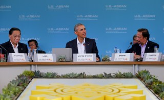 U.S. President Barack Obama hosts a 10-nation Association of Southeast Asian Nations (ASEAN) summit in Rancho Mirage, California February 15, 2016. Obama will press leaders from Southeast Asia to boost trade and back a common stance on the South China Sea. Seated left is Choummaly Sayasone, President of the Lao People's Democratic Republic and at right Sultan of Brunei Hassanal Bolkiah.                 REUTERS/Mike Blake  - RTX2736Q