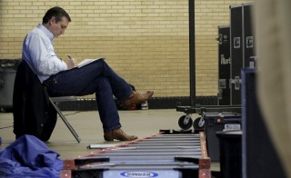 Republican presidential candidate Senator Ted Cruz (R-TX) makes notes before speaking at a campaign event in Columbia, South Carolina. Photo by Joshua Roberts/Reuters