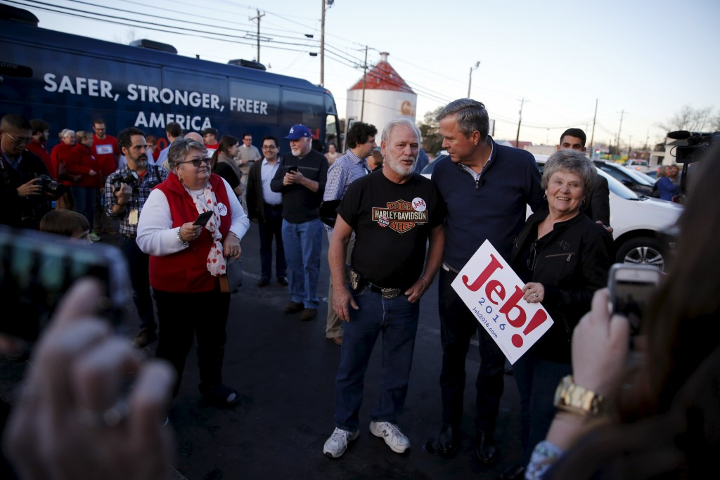 Republican presidential candidate Jeb Bush (2nd R) greets voters after speaking at Shealy's Bar-B-Que in Leesville, South Carolina. Photo by Jonathan Ernst/Reuters