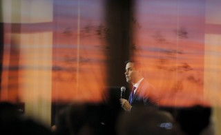 Republican presidential candidate Marco Rubio is seen through the glass windows as he speaks during a campaign town hall at Barefoot Resort in North Myrtle Beach, South Carolina. Photo by Chris Keane/Reuters