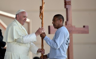 Pope Francis receives a cross made by an inmate during his visit to the CeReSo n. 3 penitentiary in Ciudad Juarez, Mexico, Wednesday. Photo by Gabriel Buoys/Pool/via Reuters