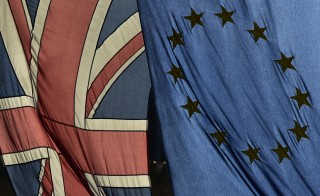 A British Union flag and a European Union flag hang from a building in central London, Britain February 18, 2016. British Prime Minister David Cameron will hold 'now or never' talks on Thursday to keep Britain in the European Union, with the bloc's leaders suggesting there are only a few obstacles left to a new membership deal.  REUTERS/Toby Melville - RTX27IFM