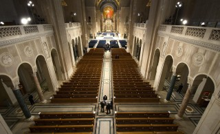 Ushers prepare for funeral Mass for Associate Justice Antonin Scalia at the Basilica of the National Shrine of the Immaculate Conception in Washington, February 20, 2016. The memorial service on Saturday was expected to be attended by scores of U.S. political leaders, who will put aside for the moment their battle over his succession.    REUTERS/Doug Mills/Pool - RTX27T0F