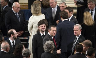 Senator Ted Cruz (C) and former Vice President Dick Cheney (upper L) take their seats for the funeral Mass for Supreme Court Associate Justice Antonin Scalia at the Basilica of the National Shrine of the Immaculate Conception in Washington February 20, 2016. Photo By Doug Mills/Reuters