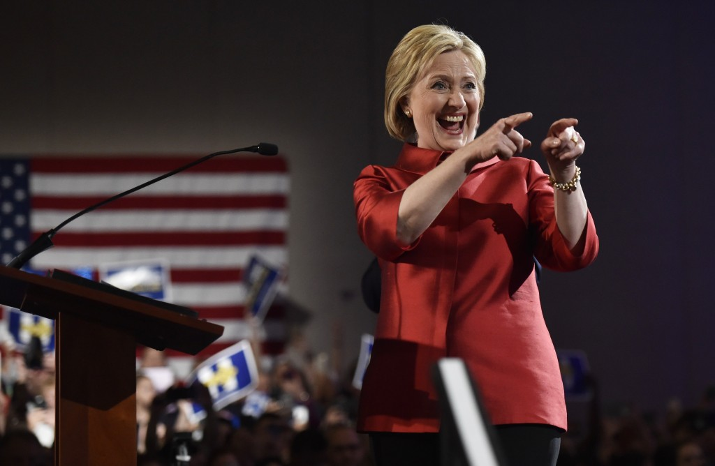 Democratic U.S. presidential candidate Hillary Clinton gestures to supporters after she was projected to be the winner in the Democratic caucuses  in Las Vegas, Nevada February 20, 2016. REUTERS/David Becker - RTX27V12