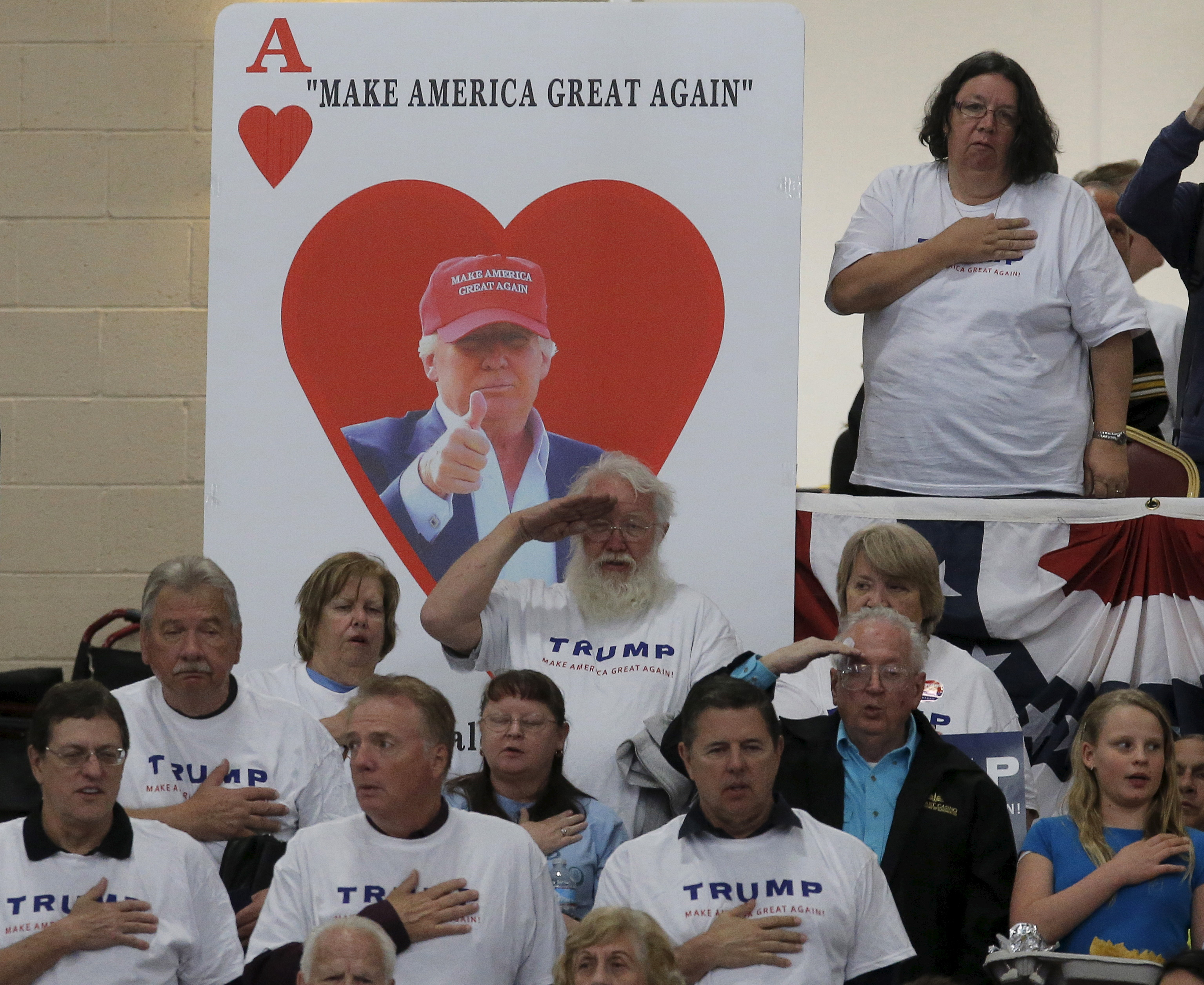 Supporters of U.S. Republican presidential candidate Donald Trump take the Pledge of Allegiance at a campaign rally in Las Vegas, Nevada. Photo by Jim Young?Reuters