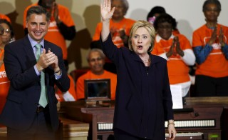 U.S. Democratic presidential candidate Hillary Clinton is applauded after a town hall meeting for supporters at Cumberland United Methodist Church in Florence, South Carolina February 25, 2016. Also pictured is Brady Campaign to Prevent Gun Violence President Dan Gross (L). REUTERS/Jonathan Ernst - RTX28MPJ