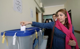 An Iranian Christian woman casts her ballot at a church during elections for the parliament and Assembly of Experts, which has the power to appoint and dismiss the supreme leader, in Tehran February 26, 2016. REUTERS/Raheb Homavandi/TIMA  ATTENTION EDITORS - THIS IMAGE WAS PROVIDED BY A THIRD PARTY. FOR EDITORIAL USE ONLY. - RTX28PMF