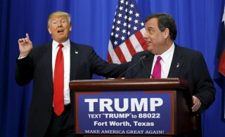 U.S. Republican presidential candidate Donald Trump (L) shakes hands with his former rival for the Republican presidential nomination, New Jersey Governor Chris Christie (R), after Christie endorsed Trump's candidacy for president at a campaign rally in Fort Worth, Texas February 26, 2016.  REUTERS/Mike Stone    TPX IMAGES OF THE DAY - RTX28RLN
