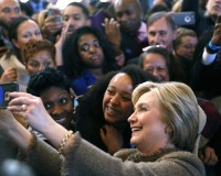 Democratic U.S. presidential candidate Hillary Clinton takes selfies with people at the Octane coffee shop during a campaign stop in Atlanta City Hall in Atlanta, Georgia February 26, 2016.   REUTERS/Christopher Aluka Berry - RTX28S6P