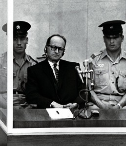 Adolf Eichmann, a Nazi S.S. colonel, stands trial inside a bulletproof booth in a Jerusalem court in 1961. Photo courtesy of Reuters