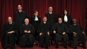 U.S. Supreme Court Justices gather for an official picture at the Supreme Court in Washington September 29, 2009. They are (front row, L-R) Justice Anthony M. Kennedy, Justice John Paul Stevens, Chief Justice John Roberts, Justice Antonin Scalia, Justice Clarence Thomas (2nd row, L-R) Justice Samuel Alito, Justice Ruth Bader Ginsburg, Justice Stephen G. Breyer, and Justice Sonia Sotomayor.   REUTERS/Jim Young   (UNITED STATES POLITICS CRIME LAW) - RTXP2UY