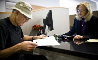 California state worker Albert Jagow (L) goes over his retirement options with Calpers Retirement Program Specialist JeanAnn Kirkpatrick at the Calpers regional office in Sacramento, California, October 21, 2009. Calpers, the largest U.S. public pension fund, manages retirement benefits for more than 1.6 million people, with assets comparable in value to the entire GDP of Israel. The Calpers investment portfolio had a historic drop in value, going from a peak of $250 billion in the fall of 2007 to $167 billion in March 2009, a loss of about a third during that period. It is now around $200 billion. REUTERS/Max Whittaker   (UNITED STATES HEALTH BUSINESS) - RTXPWOI  RElated words: retirement, Social Security, retirement planner, benefits, old, older people, senior, seniors