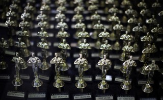 Miniature Oscar statuettes sit in a souvenir store display window in Hollywood, Los Angeles, California. Photo by Lucy Nicholson/Reuters