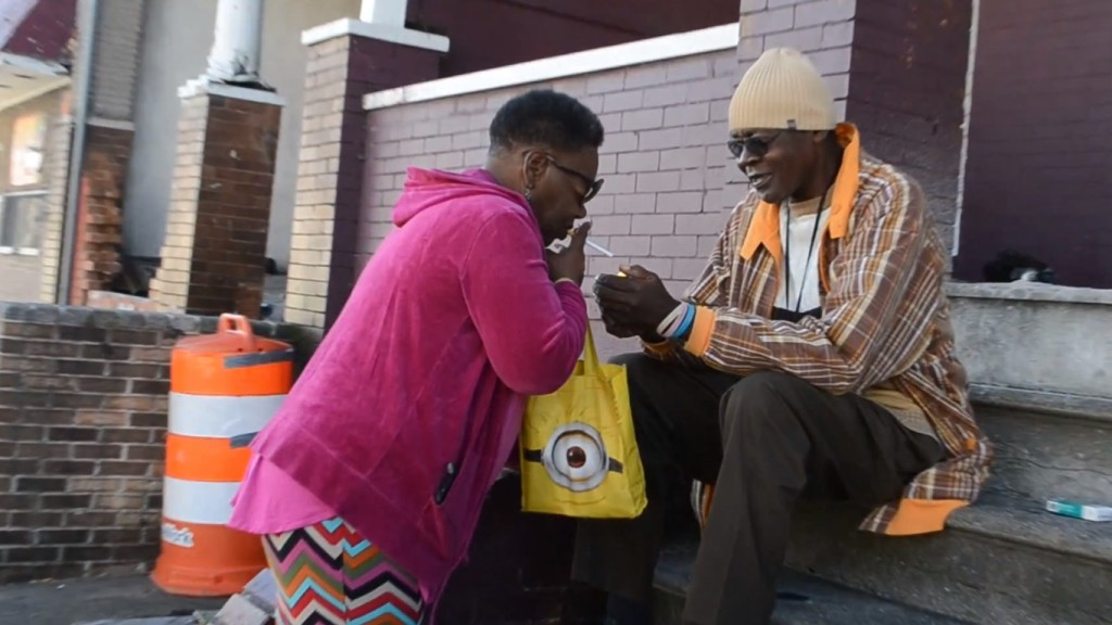 Sharlene Adams bought one cigarette from a neighbor as she waited for a bus. Photo by Rachel Bluth/Capital News Service.