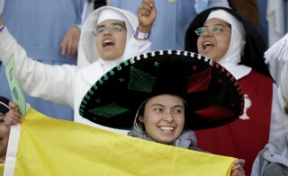 People participate in a Mass by Pope Francis (not pictured) at Venustiano Carranza stadium in Morelia, Mexico on Feb. 16, 2016. Photo by Max Rossi/Reuters