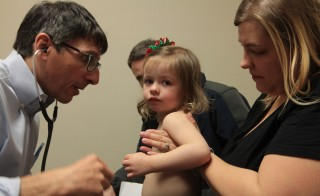 Since Brynleigh's diagnosis, Lauren and Sean Shillinger have educated themselves about their daughter's rare genetic disorder. During her regularly scheduled two-year check-up, the Shillingers fielded questions from their pediatrician, Paul Feinberg, such as whether or not surgery could remove one of the tumors in her brain. Photo by Joshua Barajas