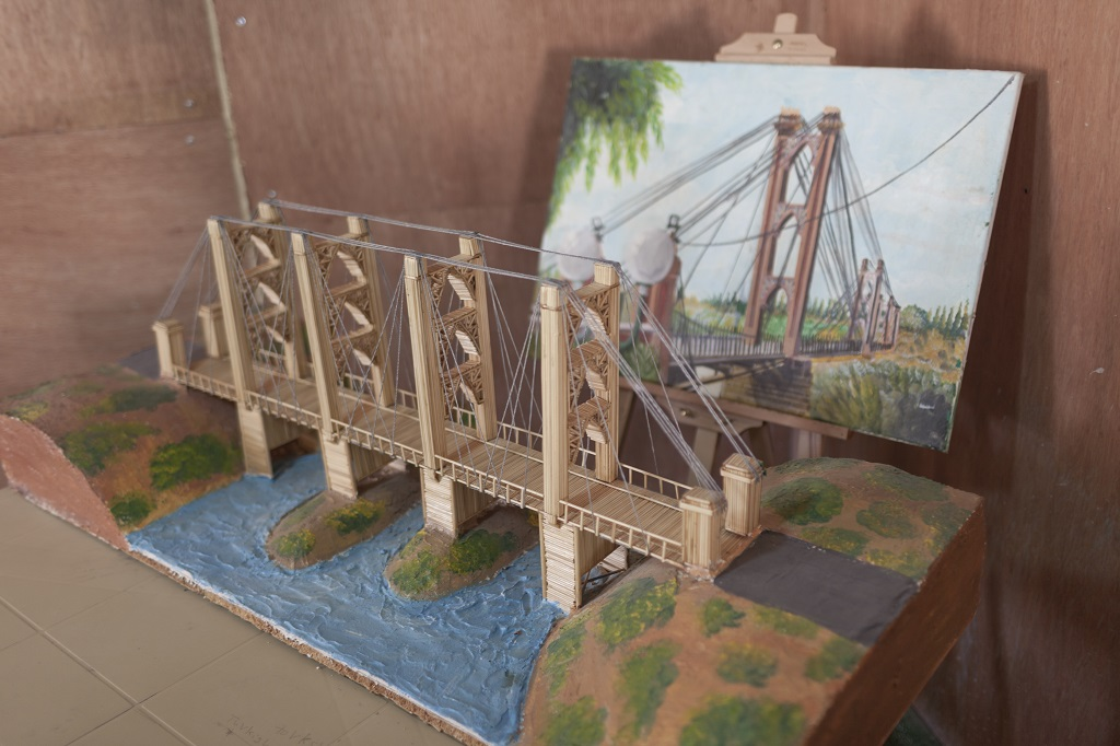 The Deir ez-Zor suspension bridge is one of the miniature replicas displayed at the community centre. Photo © UNHCR/Christopher Herwig