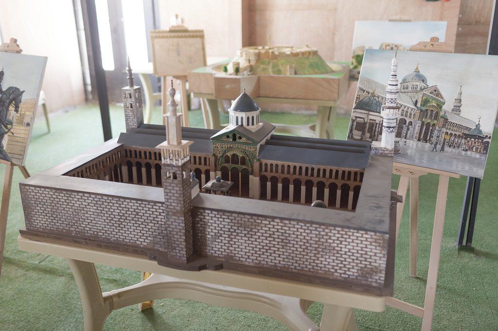 Damascus's Umayyad Mosque is one of the miniature replicas displayed at the community centre. Photo © UNHCR/Christopher Herwig