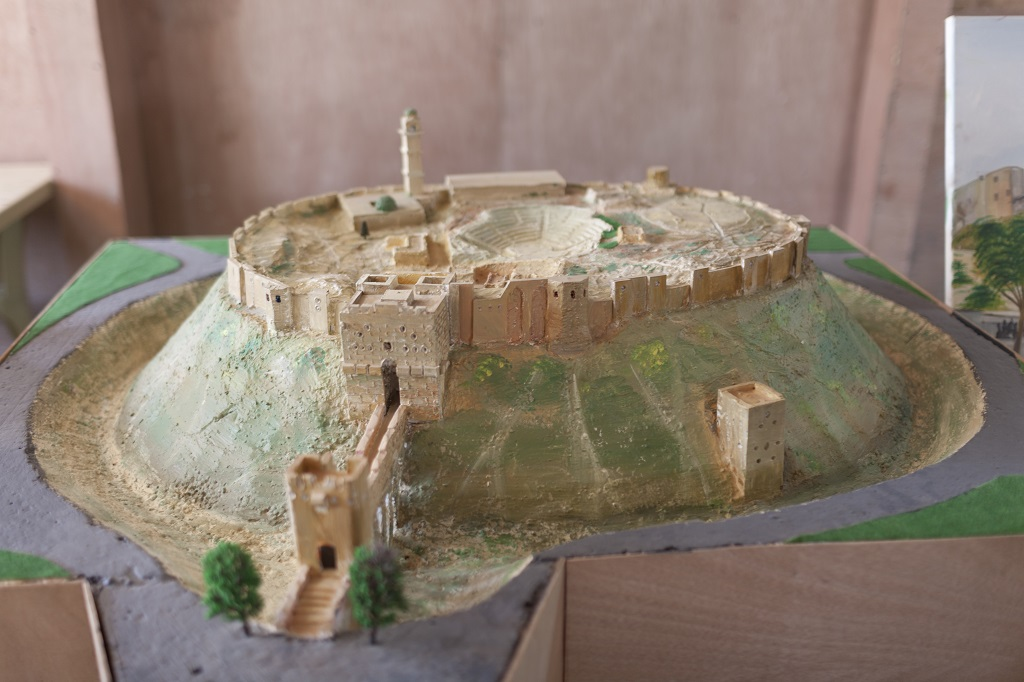 The Citadel of Aleppo is one of the miniature replicas displayed at the community centre. Photo © UNHCR/Christopher Herwig