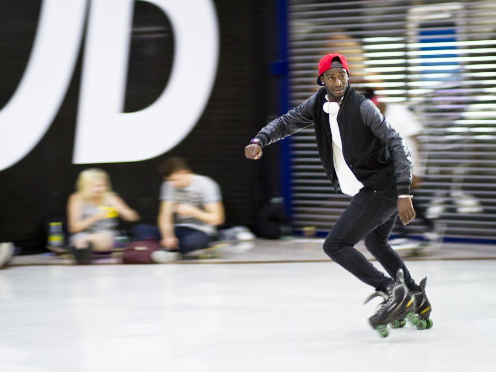 A young rollerblader slaloming with speed and agility between the pedestrians. Photo and caption by Carla da Silva