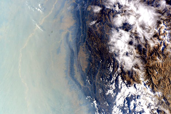 Air pollution covers the northeastern side of the Himalayas. Photo by Scott Kelly/NASA/via Twitter