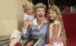 "Award-winning actress Patty Duke poses for photographers with her granddaughters, 2-year-old Elizabeth Astin (left) and 7-year-old Alexandra Astin following an unveiling ceremony, honoring Duke with the 2,260th star on the Hollywood Walk of Fame in Los Angeles, California on Aug. 17, 2004. Duke won the Oscar for best supporting actress for ""The Miracle Worker"" at 16, the youngest at the time to be so named. Photo by Jim Ruymen/Reuters"