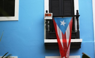 For some, Puerto Rico is a U.S. territory. For others, it's the world's oldest colony. The one thing Puerto Ricans don't want the island to be: just another political talking point. Photo by Joe Raedle/Getty Images.