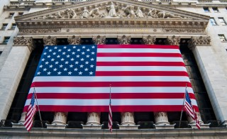 USA, New York City, Close up of New York Stock Exchange's facade with american flag