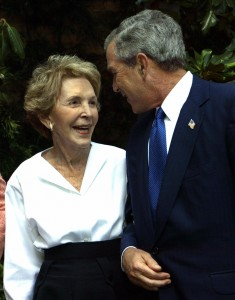 BEL AIR, UNITED STATES: US President George W. Bush and Nancy Reagan share some private time together as the President and First Lady Laura Bush stopped by to pay their respects to Mrs. Reagan 12 August, 2004, at her home in Bel Air, California AFP Photo/Paul J. Richards (Photo credit should read PAUL J. RICHARDS/AFP/Getty Images)