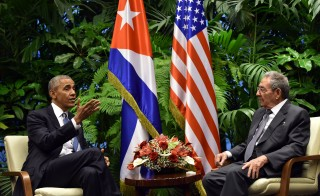 TOPSHOT - US President Barack Obama (L) and Cuban President Raul Castro meet at the Revolution Palace in Havana on March 21, 2016. US President Barack Obama and his Cuban counterpart Raul Castro met Monday in Havana's Palace of the Revolution for groundbreaking talks on ending the standoff between the two neighbors. Obama, meeting Castro for only the third time for formal talks, was the first US president in Cuba since 1928.  AFP PHOTO/ NICHOLAS KAMM / AFP / NICHOLAS KAMM        (Photo credit should read NICHOLAS KAMM/AFP/Getty Images)