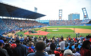 People wait for the start of a baseball exhibition game between Cuba and the MLB's Tampa Bay Rays at the Latinoamericano Stadium in Havana. Photo by Yamil Lage/AFP/Getty Images