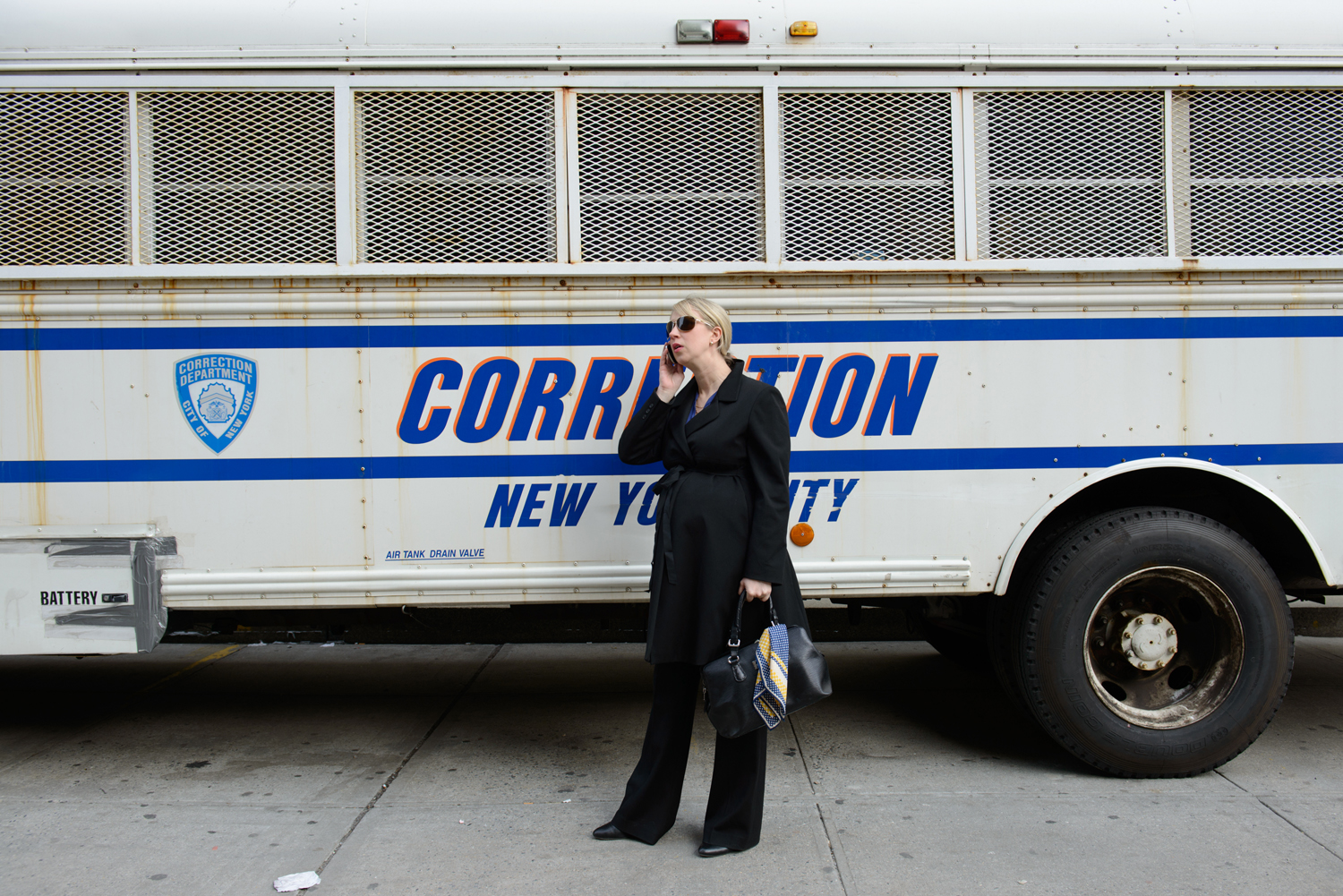 Pregnant Assistant District Attorney Lucy Lang talks on the phone outside of her office.
