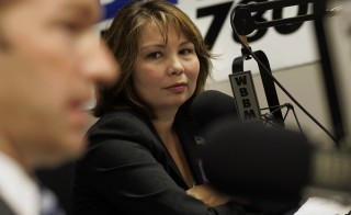 Iraq War veteran and Democratic Congressional candidate Tammy Duckworth (R) debates her opponent Peter Roskam at WBBM radio in Chicago September 22, 2006. Duckworth was co-piloting a Black Hawk helicopter north of Baghdad on November 12, 2004, when a rocket-propelled grenade struck the cockpit of her aircraft and exploded. Ten days later, when she woke up at Walter Reed Memorial Hospital in Maryland, she learned that the explosion would cost her both legs and had shattered her right arm. REUTERS/John Gress (UNITED STATES) - RTR1HMMO