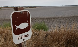 A fishing sign in at one of the dry pools at the Quivira National Wildlife Refuge in Hudson, Kansas August 7, 2012. One of the biggest droughts in U.S. history struck the Midwest in 2012. Photo by Jeff Tuttle/REUTERS