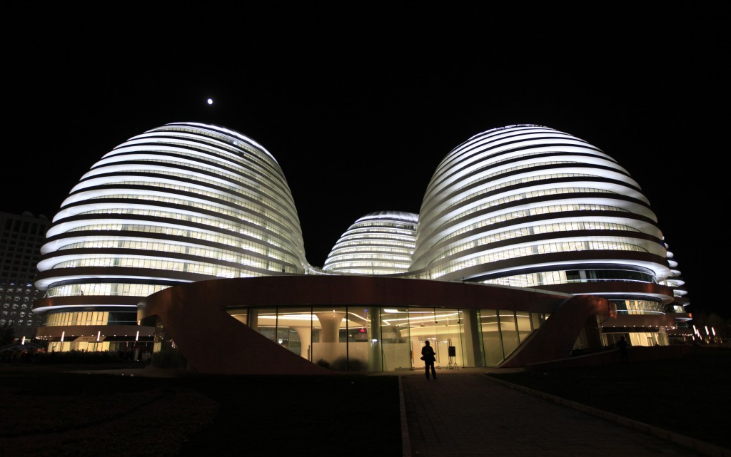A visitor walks at the newly opened Galaxy Soho building, designed by Iraqi-British architect Zaha Hadid, in Beijing October 27, 2012. REUTERS/Jason Lee (CHINA - Tags: BUSINESS SOCIETY) - RTR39NFJ
