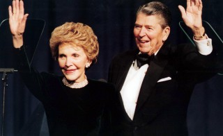 "Former U.S. President Ronald Reagan fell at his Los Angeles home January 12, 2001 and was taken to a hospital, where he will have surgery for a hip fracture, his spokeswoman said. The spokeswoman said Reagan, 89, was in stable condition at a local hospital and ""in good humor."" She said his wife, former first lady Nancy Reagan, was with him. Reagan and his wife Nancy wave in this file photo while attending a gala celebrating his 83rd birthday, February 3, 1994 in Washington.  ME - RTRCW55"