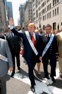 Entrepreneur Donald Trump (red tie) marches as the Grand Marshall in the Salute to Israel Parade in New York, May 23, 2004. Thousands marched along fifth avenue in New York showing their support and pride for Israel. REUTERS/Seth Wenig  SW/HB - RTRK7OI