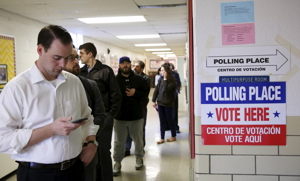 Virginia voters line up early to cast their ballots in Super Tuesday elections at the Wilson School in Arlington, Virginia March 1, 2016. Photo by Gary Cameron/Reuters