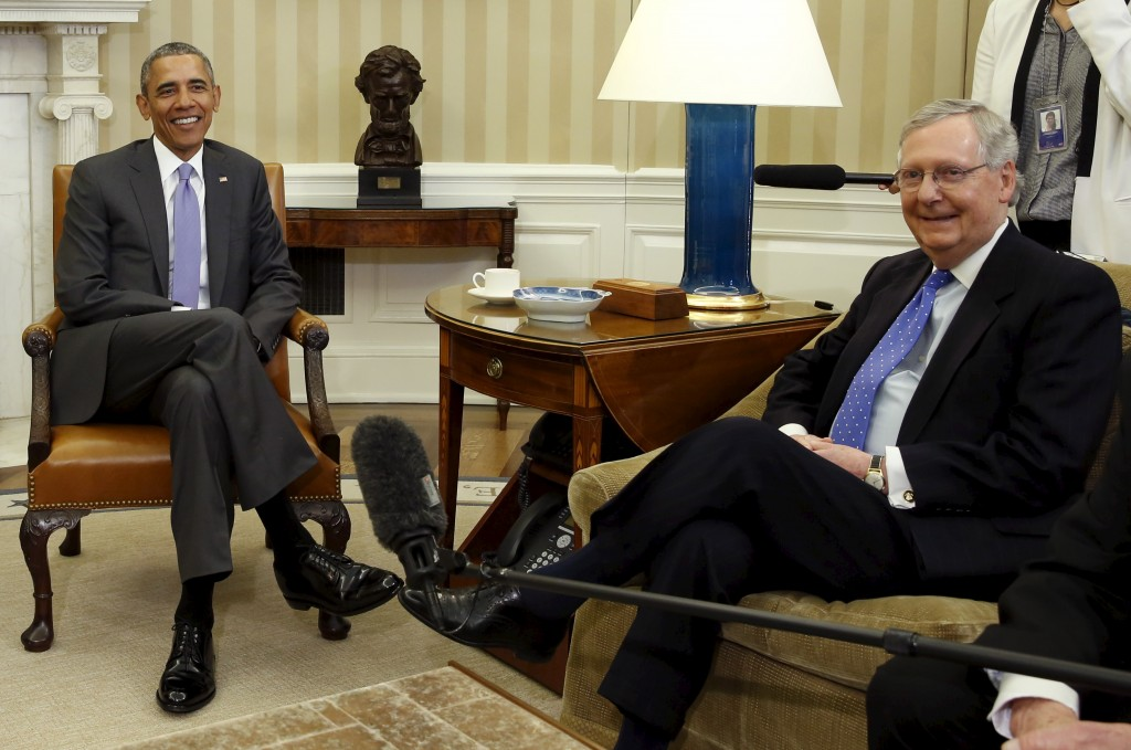 U.S. President Barack Obama (L) sits next to Senate Majority Leader Mitch McConnell (R-KY) during a meeting with the bipartisan leaders of the Senate to discuss the Supreme Court vacancy left by the death of Justice Antonin Scalia at the White House in Washington March 1, 2016. Republican opposition to the president may have helped lead to the rise of Donald Trump's presidential candidacy. Yuri Gripas/Reuters