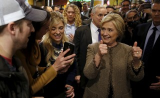 U.S. Democratic presidential candidate Hillary Clinton greets people at Midtown Global Market in Minneapolis, Minnesota March 1, 2016. REUTERS/Jonathan Ernst - RTS8T6T
