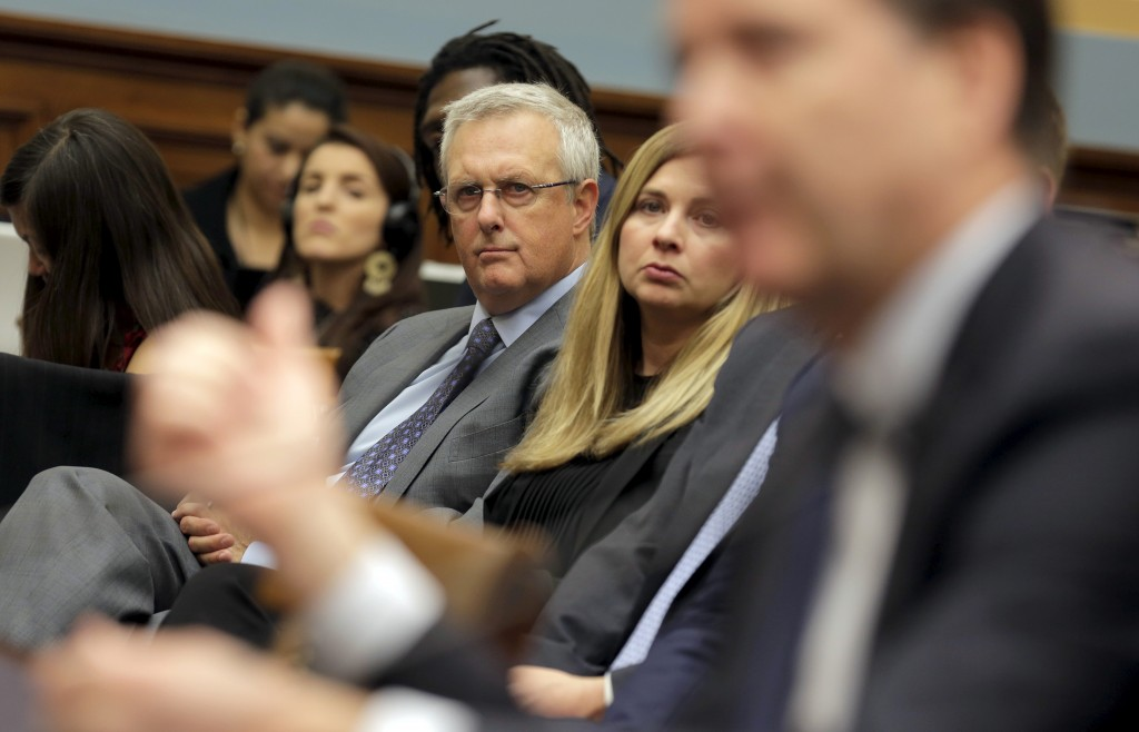 "Bruce Sewell, senior vice president and general counsel for Apple Inc., watches as FBI Director James Comey testifies during a House Judiciary hearing on ""The Encryption Tightrope: Balancing Americans' Security and Privacy"" on Capitol Hill in Washington, D.C. Photo by Joshua Roberts/Reuters"
