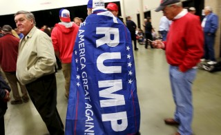 Supporter Alex Himes walks through the crowd before Republican U.S. presidential candidate Donald Trump speaks at a Super Tuesday campaign rally in Louisville, Kentucky on March 1. Photo by REUTERS/ Chris Bergin