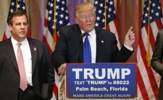 Republican U.S. presidential candidate Donald Trump, with former rival candidate Governor Chris Christie (L) at his side, speaks about the results of Super Tuesday primary and caucus voting during a news conference in Palm Beach, Florida March 1, 2016.  REUTERS/Scott Audette - RTS8V1N