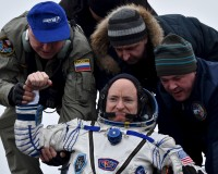 Ground personnel help U.S. astronaut Scott Kelly to get out of a Soyuz capsule shortly after landing near the town of Dzhezkazgan (Zhezkazgan), Kazakhstan, March 2, 2016. REUTERS/Kirill Kudryavtsev/Pool - RTS8VED