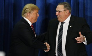 Republican U.S. presidential candidate Donald Trump shakes hands with Maine Governor Paul LePage (R) after LePage introduced him at a campaign rally in Portland, Maine March 3, 2016. Photo by  Joel Page/Reuters